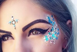 glitter sparkling makeup in blue colors with cut crease