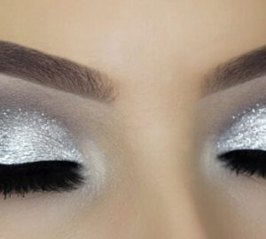 glitter eye make up with cut crease long lashes and perfect brows
