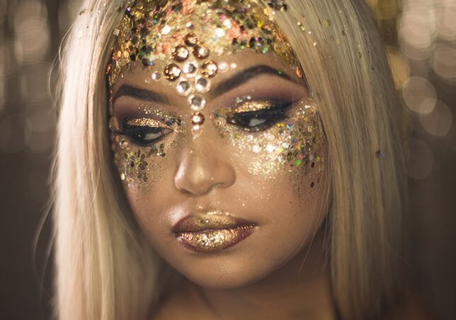 woman with golden metallic makeup