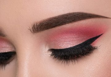 girl with pink eye makeup and perfect brow makeup