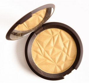 Becca Skin Perfector in Champagne Pop highlighter open package