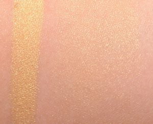Becca Skin Perfector in Champagne Pop highlighter swatch on skin