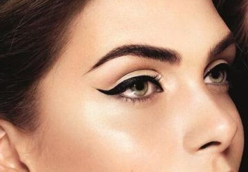 girl with lined eyes perfect brows and lighlighter on cheek bones