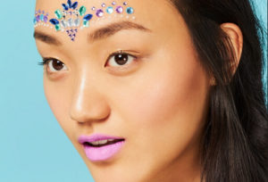 girl wearing makeup with glitter and gems