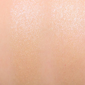 too faced starlight natural highlighter swatch on skin