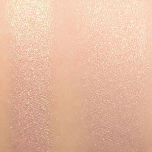 too faced satin sheets highlighter natural swatch on skin
